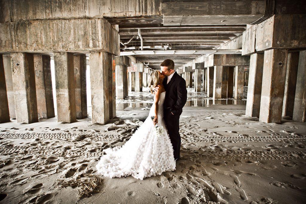 Couple under the Pier 1024x683 - Couples & Bridal Parties
