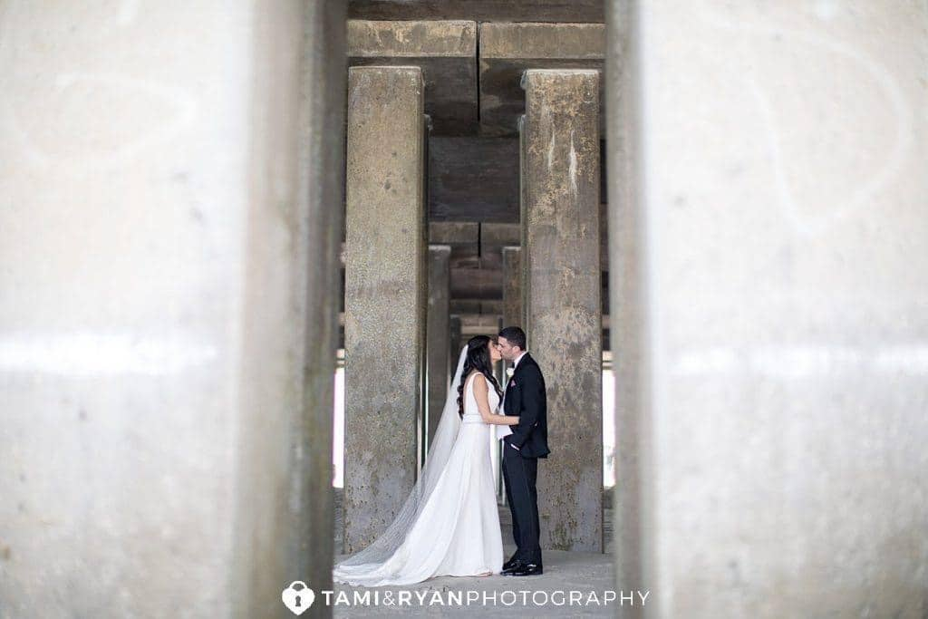 Couple under the boardwalk - Couples & Bridal Parties